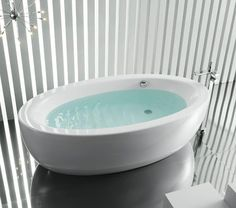 Oval freestanding bath. Modern looking stunning freestanding bath in white. #bath