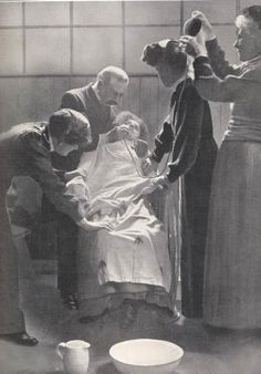Force feeding suffragettes in prison 1912