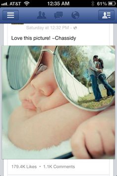 Baby wearing big sunglasses...and with the parents kissing in the reflection of the lenses! Cute family picture idea.