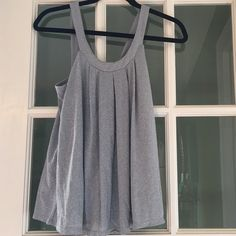 Silver Jennifer Lopez Top XS NWOT 64% Rayon 22% Nylon 14% Metallic. ⭐Like the item but not the price? Make an offer or checkout Ⓜ️ercari. I have most of my items listed there as well ⭐️ Jennifer Lopez Tops Tank Tops