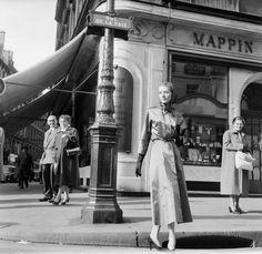 A Woman Strolling On Rue De La Paix