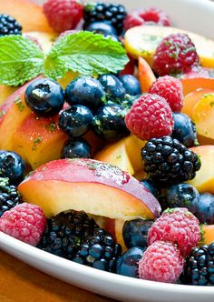 "Fruit salad: Peaches and Berries with Lemon-Mint Syrup! ""Beautiful, healthy and delicious fruit salad! Refreshing (Ahhh), the fresh chopped mint really adds a nice flavor especially when you get a sliver with a peach...Mmmm!"" #weightloss"