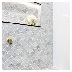 Anyone else want to dive into our Little Mermaid bathroom?! #bathroominspo #marble #tiles #marbletiles