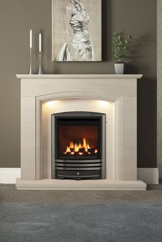 Elissa Limestone surround with Smartsense lights featuring a Be Modern gas fire with Cast trim in Nickel Faux Fireplace Mantels, Limestone Fireplace, Home Fireplace, Fireplace Remodel, Living Room With Fireplace, Fireplace Design, Living Room Decor Cozy, Paint Colors For Living Room, Home Living Room
