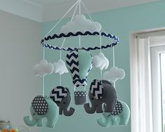 Welcome to Flossytot  This Elephant Mobile is MADE TO ORDER   This mobile consists of 4 elephants, made using premium wool blend felt in pale mint green/polka dot grey and grey /navy chevron. Above each elephant is a cloud. Hanging in the centre is a Hot Air Balloon using the same colours used on the elephants.  CUSTOMISE You can also choose your own colours to match your nursery , just convo me to discuss!  These mobiles are original Flossytots designs and are carefully cut and handstitched…