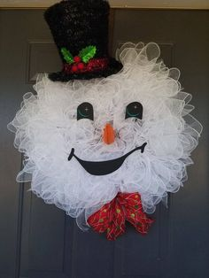 Best 12 Let Frosty great your guests with his whimsical expression and infectious smile. – 24 inch (Top hat adds an additional 12 inches) – Hand painted eyes – Felt Nose – Sparkly garland Hat Christmas Wreaths For Front Door, Christmas Door Decorations, Burlap Christmas, Deco Mesh Wreaths, Holiday Wreaths, Winter Wreaths, Ribbon Wreaths, Yarn Wreaths, Floral Wreaths