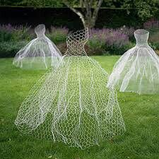 Chicken wire body silhouettes. Use glow in the dark spray paint so at night they appear to be floating around!!