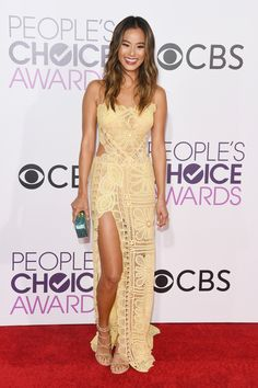 Wow! Jamie Chung blew us away with her strapless canary yellow gown with slit that showed off her slinky legs. (Photo by Alberto E. Rodriguez/Getty Images)  via @AOL_Lifestyle Read more: https://www.aol.com/article/entertainment/2017/01/18/peoples-choice-awards-2017-red-carpet-arrivals/21657915/?a_dgi=aolshare_pinterest#fullscreen