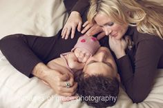 newborn with parents picture
