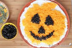 Easy Halloween Recipe - Jack O' Lantern Olive Cheese Dip - Make the eyes, nose and mouth using chopped black olives.