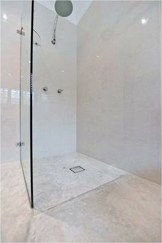Shower with concrete floor by @concreateau #concrete #flooring #shower #bathroom