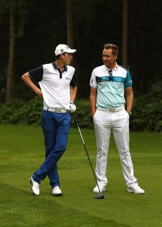Ian Poulter giving some golfing advice to a junior
