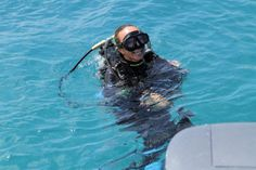 The dive instructor Michaela getting ready for an afternoon dive at Three Rocks dive site in Sosua. Three Rocks are three giant coral heads that span 45 meters (150 ft.), hosting an incredible mix of tropical fish and plant life.