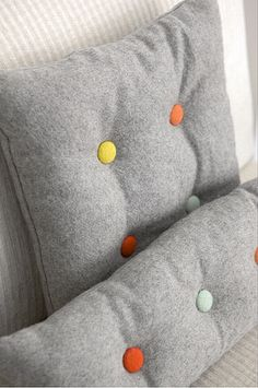 cushion with buttons on grey