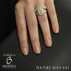 Amp up the glam factor with a unique wedding set by HENRI DAUSSI, available at Brinker's Jewelers!