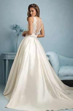 The taffeta skirt is paired with a sheer bodice and crystal beading at the waist. Allure, 2015 wedding dress collection