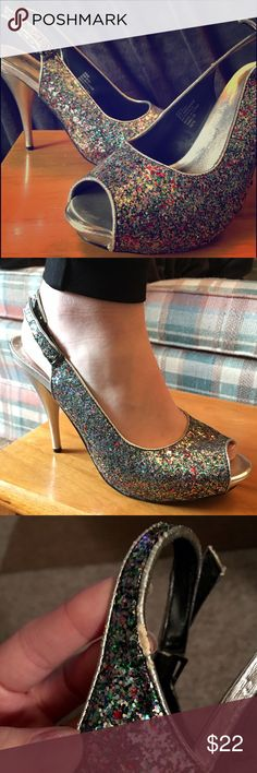 Glittery Peep-Toe Heels Gorgeous pair of heels that definitely stand out! The perfect way to spice up a simple outfit. Silver with multicolored glitter. Only imperfection (shown in picture) is that one of the straps has a little bit worn off on the edge. Other than that they are in excellent condition, only worn twice. City Streets Shoes Heels