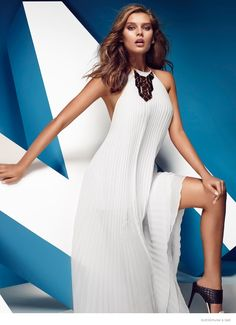 A white Guess by Marciano maxi dress with a halter top.