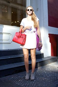 Soho - White skirt, red bag, and gray ankle boots