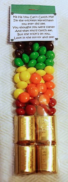 Set up a trap to try to catch the leprechaun, but he was too tricky and instead played a trick on the kids - he painted green shamrocks on their faces and hands while they slept!    Use Wilton pretzel bags, the perfect width for two Hershey's Nuggets.  Skittles or M work great for the rainbow part.