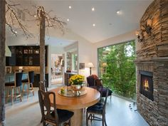Lovely breakfast nook with stone fireplace and large window.