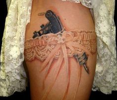 not that tattoo gun but the coloring and shading on the garter is perfect