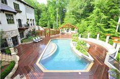 Gorgeous In-Ground Pool surrounded by Wooden Deck