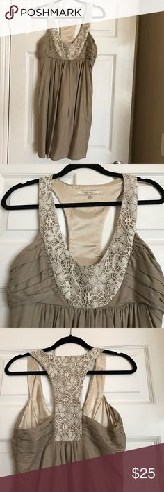 Tan Dress with Lace Embellishment size 6 Tan Dress with white Lace embellishment on front and the back (racetrack). Material is tan but has slight gold shimmer to it, very subtle. Molly New York brand from urban outfitters. Kept covered. Urban Outfitters Dresses Midi
