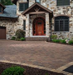 """Combining rich, earth tone colors with textured surfaces creates an authentic """"old world"""" appearance. Driveway Design, Driveway Pavers, Driveway Ideas, Belgard Pavers, Outdoor Paving, Paving Ideas, Earth Tone Colors, Outdoor Spaces, Outdoor Decor"""