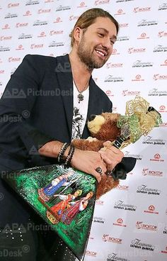 MOSCOW, RUSSIA. NOVEMBER 19, 2013. German violinist David Garrett playing the violin during a press conference ahead of the Russian premiere of The Devil' s Violinist film directed by Bernard Rose. Gifts from Russian fans - balalaika and the bear
