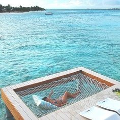 Rope hammock over the water attached to the deck