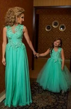 One day a boy will feel a little shy at first but soon will enjoy wearing a beautiful dress just like his Mommy!