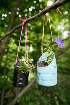 A tutorial to how to make your own DIY hanging planters using recycled plastic bottles and paint.