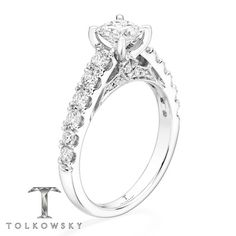 This radiant engagement ring from Tolkowsky® features a Princess Ideal Cut Diamond at the center, with sparkling round diamonds along the band, for a total diamond weight of 1 3/8 carats. The ring is styled in 14K white gold. Diamond Total Carat Weight may range from 1.37 - 1.44 carats.