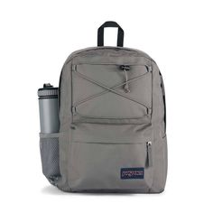 JanSport Flex Pack Backpack features: Made in part with recycled materials One large main compartment with bungee cord system to manange over flow storage Internal sleeve fits 15 in laptop Side water bottle pocket Front Zipper Pocket with organizer Fully padded back panel Grey Backpacks, School Backpacks, Jansport Backpack, Mini Backpack, Handbags For School, Bungee Cord, Pink Parties, Graphite, Laptop Sleeves