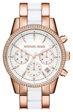 This white and rose gold watch from Michael Kors has just the perfect amount of bling. Love it!