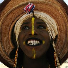 Tuaregs and Wodaabes take part in the Cure Salee in Ingall, northern Niger, on 25 September 2010.  The Cure Salee is a special festival where men dress up in finest clothes and paint their faces (to enhance beauty) and look for a wife.