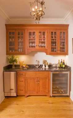 I like the idea of a beverage center close to but outside with traffic area of the kitchen. It should include sink for the coffee pot, an ice maker, and small fridge for sodas.