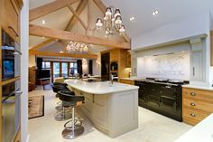 Showing the hand painted island which contrasts nicely with the light oak look of the kitchen