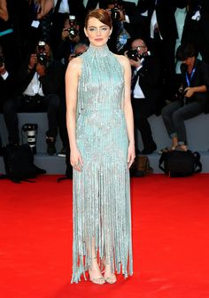 Emma Stone in Atelier Versace's custom-made floor-length, fringed dress with Jimmy Choo sandals and Selim Mouzannar jewelry.