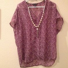 """VICTORIA SECRET SHORT SLEEVE V NECK Beautiful semi sheer top. New condition.  26"""" from shoulder to front hem.  Back hem is 2"""" lower.100% polyester. Last pic is for fit only Victoria's Secret Tops Blouses"""