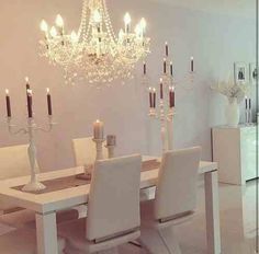 Creamy and contemporary, with a beautiful chandelier