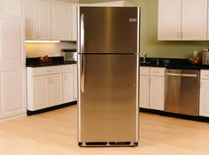 Clad in full stainless steel, this simple Frigidaire fridge is billed as an affordable top-freezer upgrade. Top Freezer Refrigerator, French Door Refrigerator, Smart Kitchen, Kitchen Appliances, Layout, Stainless Steel, Simple, Board, Pictures
