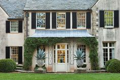 Landscape artist John Howard designed the landscape for Danielle Rollins's beautiful home Boxwood in  Atlanta.