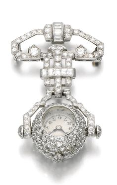 DIAMOND LAPEL WATCH, 1930S The spherical case pavé-set with single-cut diamonds, the circular dial applied with Arabic numerals, suspended from a similarly set brooch surmount of open work geometric design, accented with baguette diamonds