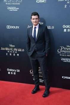 Orlando Bloom in Prada while attending the premiere of 'Pirates of the Caribbean: Dead Men Tell No Tales' on May 11th, 2017 in Shanghai.