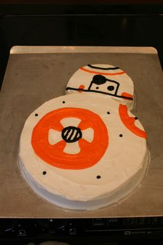 BB-8 Droid Birthday Cake Just make 2 round cakes and carve one for it's head. Frost & decorate. He loved it!