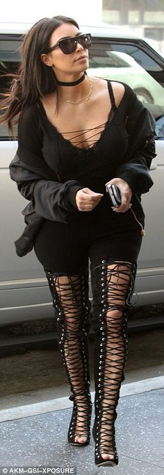 Casual outing? The 35-year-old reality star teamed Tony Bianco thigh-high boots with a lac...