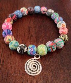 Multicolored Spiral Charm Stretch Bracelet. $10.00, via Etsy.