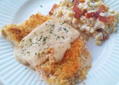 Chicken Cordon Bleu - halve chicken breasts through the middle, cover each half with a slice of ham and swiss cheese, nuts (original uses Panko crumbs), bake for 30-35 minutes.